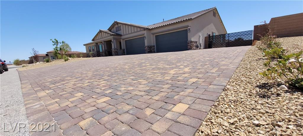Largest spacious, private cornor lot in the entire Community welcomes you to over 4000 sqft of Luxury Resort Style living.  Conveniently located in the most demanding Southwest part of town with 4 Bedroom, 3 Full Bath and Mountain Views!!! Spectacular home with over $60K in upgrades, 4th generation home with all the latest technology, newly finished back yard, enjoy the 90 degree covered patio and double Sliding doors to the patio, RV Parking space, centrally located community. Beauthiful layout home with latest building design and decore. As you walk in there is great formal dinning room on your right that opens to a large and spacious living room connected with beautiful kitchen. Large separate master suite with its own seperated master bath, shower, tub, make-up and exercise room. Don't forget to see the newly finished back yard. Many and Many more features to mention.