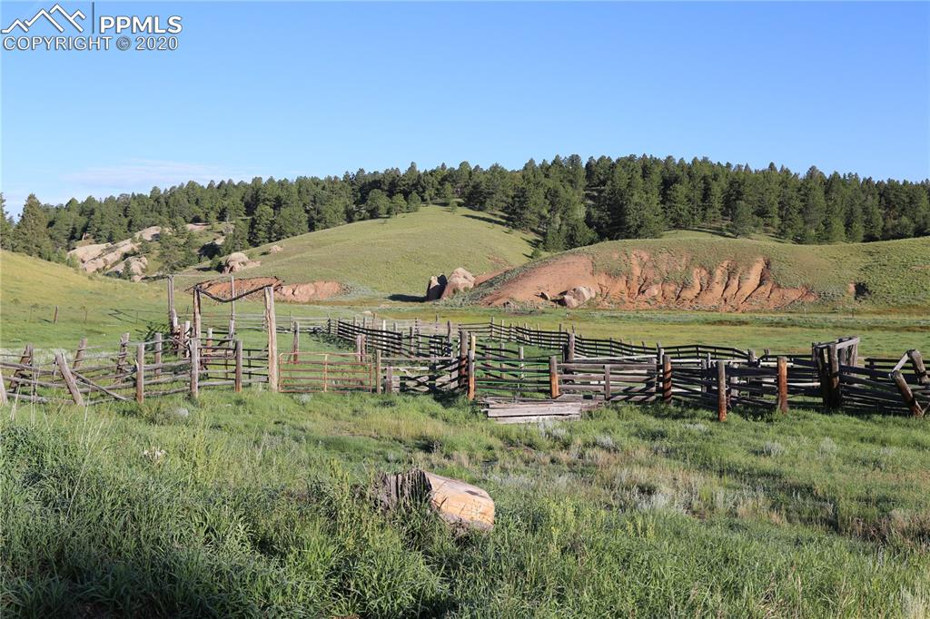 1146  +/-acre Ute Pass Ranch north portion. This is bordered by Hwy 24 on the south for super easy access. Pikes Peak views to die for with varied terrain that has aspen, pine and spruce with ranch headquarters that include large utility building with overhead doors. Twin Creek runs through this property. Historically used for cattle grazing and hunting lease, this property has a resident elk herd and plenty of mule deer. Potential for a future conservation easement or possible development into 35 acre or larger tracts.