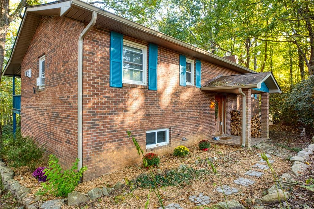 $2,000.00 BUYER BONUS at closing! That means money back in your pocket when you close on this home, if you go under contract before Oct 31, 2020. VERY MOTIVATED SELLER!!! 3 total big bedrooms + an extra large bonus room. 2 full baths. Master bedroom easily big enough to add an ensuite. Plenty of closets and cabinet storage. New flooring in the upstairs bath. New modern kitchen faucet. Dishwasher is only a year old. Big laundry room with more room for storage. Wood burning fireplace to keep things cozy on the mountain. Quiet area with almost an acre of partially wooded, partially fenced property with a built in fire pit. Covered full length 2nd story deck for early morning coffee and views or late night gatherings. Trees surrounding home provide privacy and energy efficiency in the spring and summer, and gorgeous mountain views in the fall and winter.  Roof, windows and gutters all replaced in 2012.