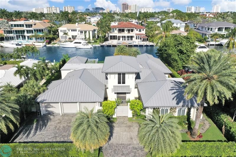Spectacular one-story coastal modern home on one of the most exclusive waterways in Harbor Beach. Residence equipped with impeccable finishes, thoughtful interior design, 105 ft of water frontage on +/-140' wide canal, boat lift, and Azek composite dock. Eat-in kitchen with high end appliances, custom cabinetry and water views. Large master bedroom with vaulted ceilings, walk-in closet, dual vanities & soaking tub in master bath. Home built with NanaWall folding doors which seamlessly blend with the outdoor living area. Home also features lush landscaping, pool, spa, cabana bath, & outdoor summer kitchen with gazebo to enjoy the beautiful breezy days and nights. Private Harbor Beach Surf Club with 300 ft of beachfront & private marina membership available.