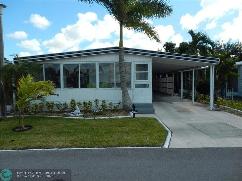 OWN THE LAND...!!!  CASH ONLY - BEAUTIFUL 2 BED 2 BATH MANUFACTURED HOME WITH AN EXTENSION LOCATED IN THE ESTATES OF FORT LAUDERDALE, THIS HOME FEATURES: A WRAP AROUND ENCLOSED FRONT PORCH WITH SLIDERS, KITCHEN IS OPEN TO THE SPACIOUS LIVING/DINING AREA. BAY WINDOW. CUTE LOUNGING AREA ON THE SIDE OF THE HOUSE. MANICURED LANDSCAPING. CARPORT PARKS 2 CARS- ROOM FOR 3 WITH TRELLISES ALONG THE SIDE FOR PRIVACY. AWNINGS & SHUTTER ALL AROUND. VERY LOW MAINTENANCE...!!! A MUST SEE...!!! DON'T DELAY, SCHEDULE YOUR PRIVATE VIEWING TODAY...!!!