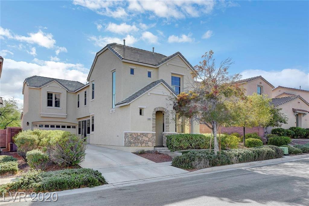 Perfection in Downtown Summerlin - in a very well sought after neighborhood!  Gorgeous home AND move-in ready.  Home features soaring ceilings with an expansive open lower level floor plan and private dining room or convert to a den/office.  Bright open kitchen/great room boasts granite prep island, gas stove, fireplace, tile flooring, wood-blinds and opens to the great outdoors...its a complete decorators delight!  Expansive master upstairs with private balcony, garden tub, separate shower, dual sinks.  Low maintenance yard with desert landscaping.  Gorgeous flagstone exterior trim and front porch for relaxing in this lovely neighborhood.  Walk to the park, Downtown Summerlin, Red Rock Casino/Resort, Aviators Stadium or just chill in this lovely home.