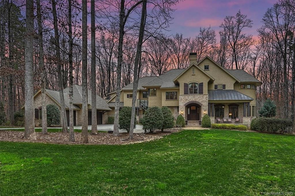 Welcome home to this custom 2.4 acre estate located on the most private cul-de-sac lots in Davidson which offers a private path leading to River Run greenway or hop on your golf cart to the club. Plenty of entertaining space from the sunken great room to the sunlit dining room with private bar or the cozy keeping room off the kitchen leading to the screened in sunporch.  Watch the big game in the fully finished lower level including exercise room, billiards area, guest room, full bath and 2nd kitchen/bar.  Full guest suite on the main is perfect for weekend guests or multi-generational living. True chef's kitchen includes an oversized island with all the luxury features such as dual dishwashers, warming drawer, Thermador 6 burner/griddle gas range/oven and large walk-in pantry.  Retreat to the upper level bonus room, 2nd laundry, study niche, 2 oversized guest suites and a beautiful master bedroom with a luxury spa bath and dual closets. This home truly has it all!