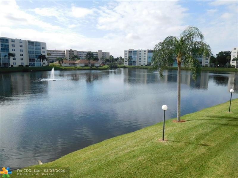 So Clean & Sold Furnished (turnkey). Great View. Just steps to shopping.  Walk or Bike to the Beach, 55+  Minutes to Airport, Casino, Jai Lai, Malls, and so much more.  Plenty of guest parking spots/Park more than one vehicle. Nearby Sawgrass, Hard Rock Hotel/Casino, Las Olas Blvd. with upscale shopping and their fine restaurants. Enjoy this peaceful lake view with its picturesque fountains while relaxing on your spacious screened patio. Sports fans will be happy to know they have a short drive to Sunlife Stadium, BB&T Center, and even Marlins Stadium or catch a few races a mile of so down the road to Gulfstream Racetrack/Casino. Shutters & Impact Windows.