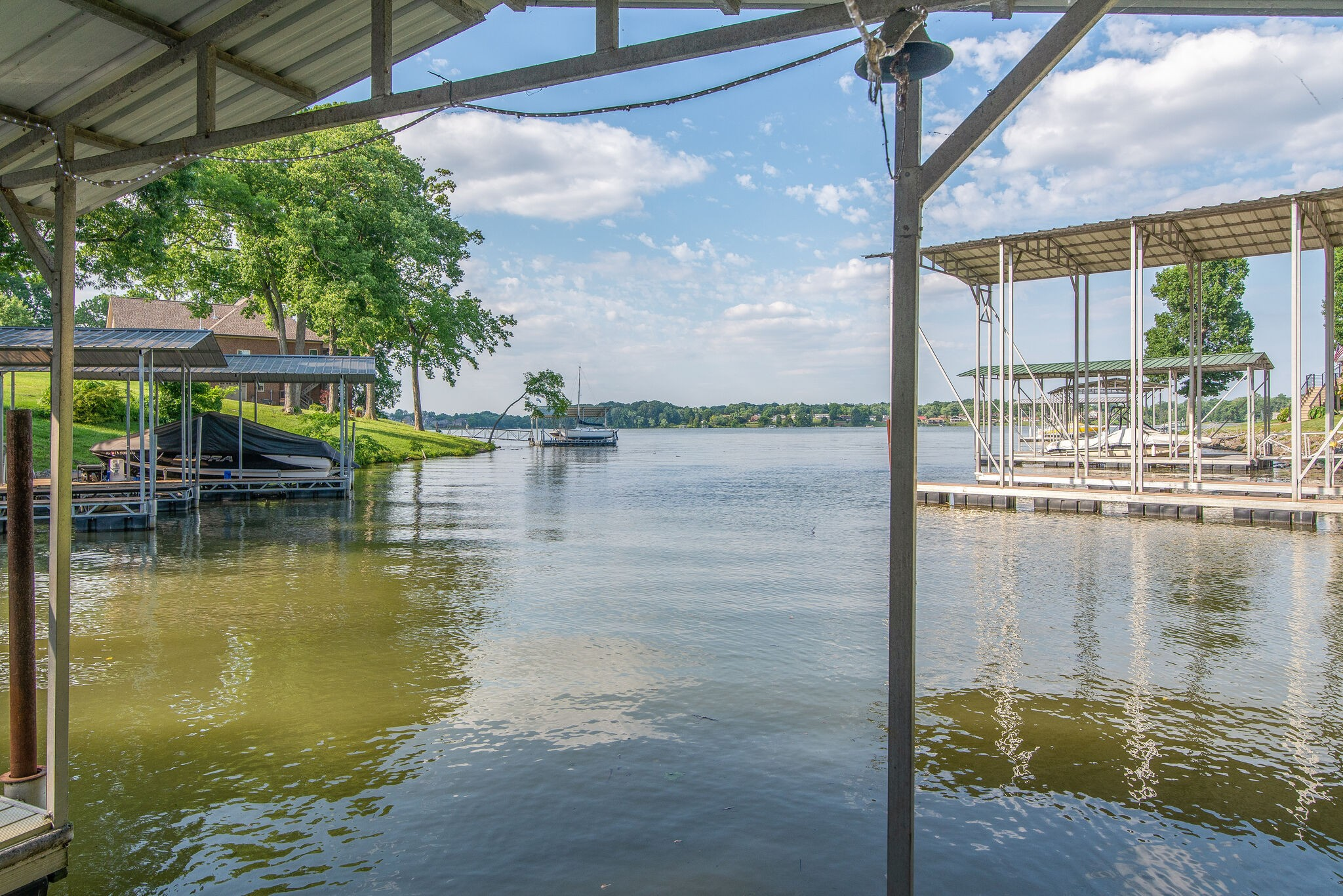 FINANCING FELL THRU - BACK ON MARKET!  FANTASTIC LAKE HOME W/ COVERED DOCK, BOAT LIFT & JET SKI HYDROPORT. Walk out to your own personal dock & hop on your boat/jet ski for a day on the lake. Step out of your master bedroom in the morning to enjoy a cup of coffee. Fabulous floor plan w/ master on the main, two bedroom upstairs & two bedrooms on the lower level both w/ private entrances to the lower deck. All bedrooms have beautiful lake views. Great office space w/ lake view & private entrance