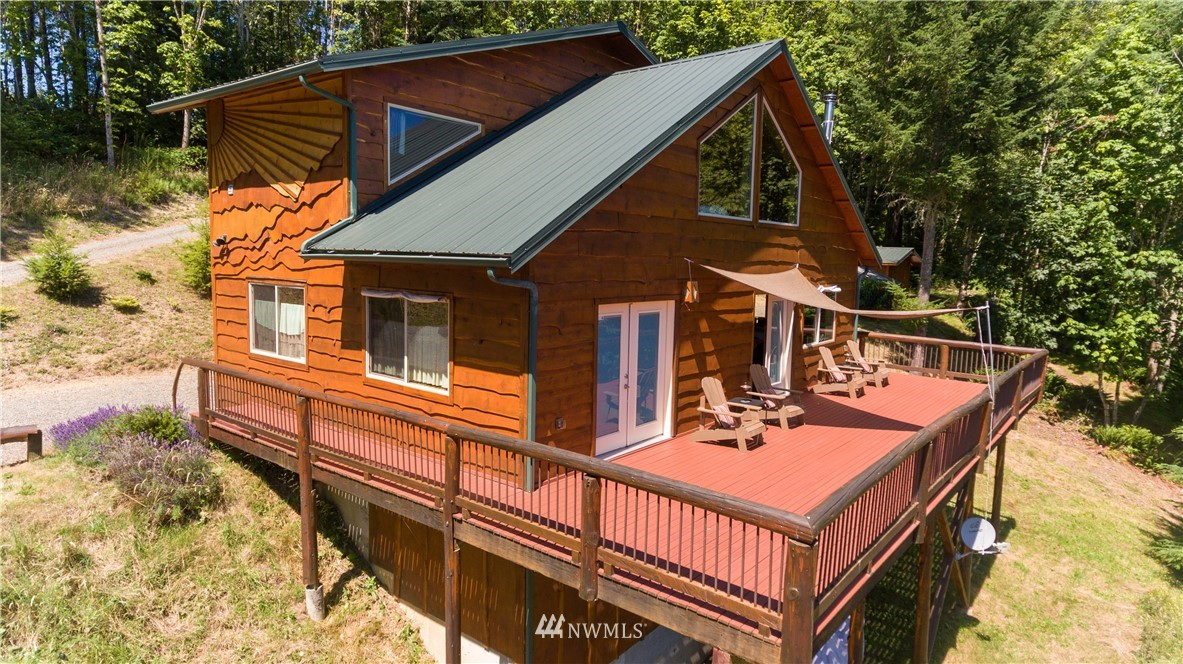 Nestled in the quiet hills of East Lewis County, you will find this custom-built home on 7+ acres that offers dynamic mountain views, designed and built by Randle Woods. On the Main Level of this unique home, you will find a spacious master bedroom with bathroom, French doors leading to your private deck, enjoy your morning beverage as you start your day or stargaze to end your night. In the kitchen there are beautiful hickory hardwood floors and stainless-steel appliances, and a woodstove. Upstairs there are 2 add'l bedrooms, bonus room and full bath, 2-decks, covered front porch and storage shed. Hike down the trail to a year-round stream that offers over 200 ft of shoreline, relax around the firepit and just enjoy nature at its best!