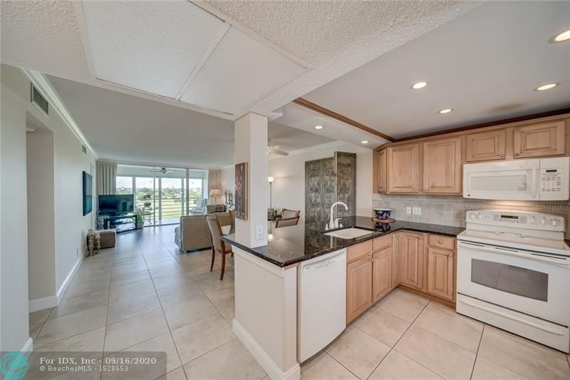 Nestled in Palm Aire Country Club with magnificent panoramic views of green landscaped golf courses, lake, and treetops—This renovated 2 bdrm/2 bath condo features a pacifying palette of color w/walls of windows allowing the natural light to shine through—Tiled floors throughout; Exposed kitchen with granite countertop, oakwood cabinetry & pantry--opens to the dinning/living area; Two Master Suites w/Two updated baths; lots of closets, & a walk-in; New water heater, Plus extra storage.  Views from screened-in patio are extraordinary, peaceful & serves as a tranquil escape. Superb amenities—just steps to pool and Clubhouse. This is a place to call home, whether it's part-time seasonal or full-time permanent!  Great location—close to restaurants, shops & airport, 10 min drive to the beach.