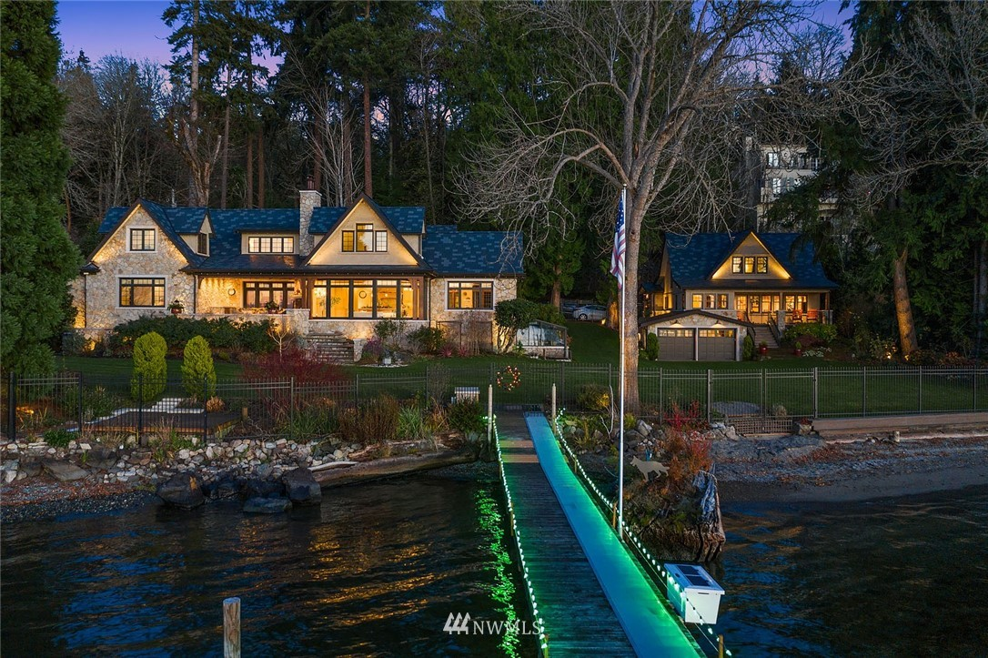 One of a kind gold coast waterfront estate with 4+ acres of privacy, 180+ ft of low bank waterfront, & expansive Western views. Exquisite custom home, meticulously crafted, & no detail overlooked from the handmade concrete window & door frames to the custom mica light fixtures. The gourmet kitchen & airy living room overlook the grounds & Lake Washington. Owner's suite with oversized windows & expansive views. The upper level features a lakeside den/office & 2 additional bedrooms. Across the lawn the guest house has two beds & the same superb views. Sprawling park-like grounds feature protected forest, walking trails, lush lawns, and so much more. An updated dock features a boat lift & swimming platform, perfect for summer days and nights.