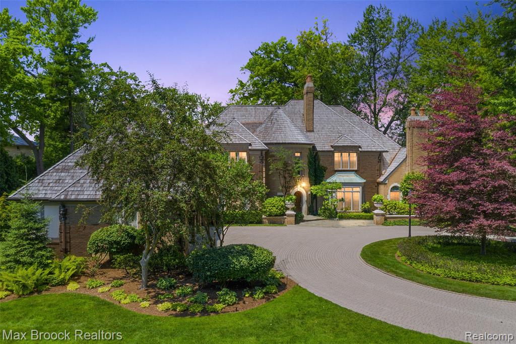 Spectacular 2 acres of luxury on Lower Long Lake! This magnificent estate offers a lifestyle of warmth & elegance. The grand entrance, soaring ceilings, sweeping staircases, wood flrs & a glorious GR/DR filled w/light all perfect for entertaining. Cook's Kitchen w/coffered ceiling, Viking, Sub Zero & Gaggenau appl., walk-in pantry & breakfast nook w/ additional lounging area opening to sprawling terrace w/breathtaking lake views of Kirk in the Hills, & for enjoying magnificent sunsets. Library offers intimate ambiance for reading or movies from your motorized recessed projector screen. 1st floor owners suite w/ sitting area, FP, private terrace & French doors leading to a glamorous dressing area w/morning bar & custom built-ins-flanked by dual baths. Upstairs 2 guest suites & cozy nook. The LL features LR, 2nd kit., FP w/ stone hearth, billiards area, addtl proj. screen, & 3 addt'l  BD Suites w/ a walkout to waterfall pool oasis, Firepit, 2 ponds, boat slip & exquisite grounds.