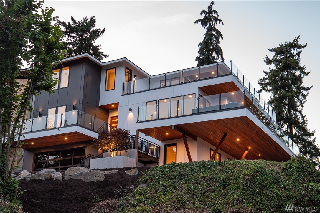 """Welcome to one of Seattle's most unique and outstanding new construction homes. Inspired by Frank Lloyd Wright's seminal design, """"Fallingwaters"""", this light filled home transitions seamlessly from indoor space to outdoor living. Situated on a one-of-a-kind 15,853 Sq. Ft. lot, this amazing home takes full advantage of the views from Mt. Baker to Mt. Rainier. The interior spaces have been designed to create an open, airy environment that allow lots of natural light in, even in the winter months."""