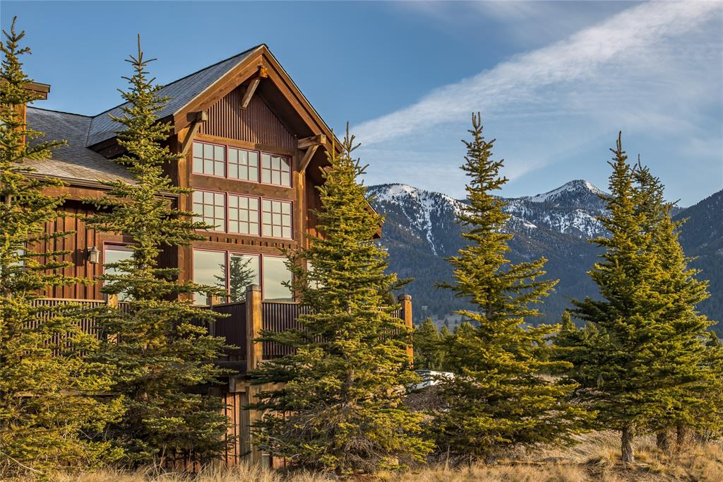 Traditional meets mountain modern in this updated, luxury condo. Nestled above the Big Sky Town Center, this property is complete with unobstructed views of the Gallatin Range, the privacy of a single family home, and the convenience of location (just a short walk into the ever-growing community or 7 miles to the world-class skiing and mountain biking at Big Sky Resort). The interior is also to envy with an open floor plan that showcases the views with vaulted ceilings and soaring windows that bring in great light no matter the time of day.  With 4 bedrooms, 4.5 baths, the expanded living room, and contemporary layout this property is truly the ideal retreat to enjoy the Big Sky lifestyle.
