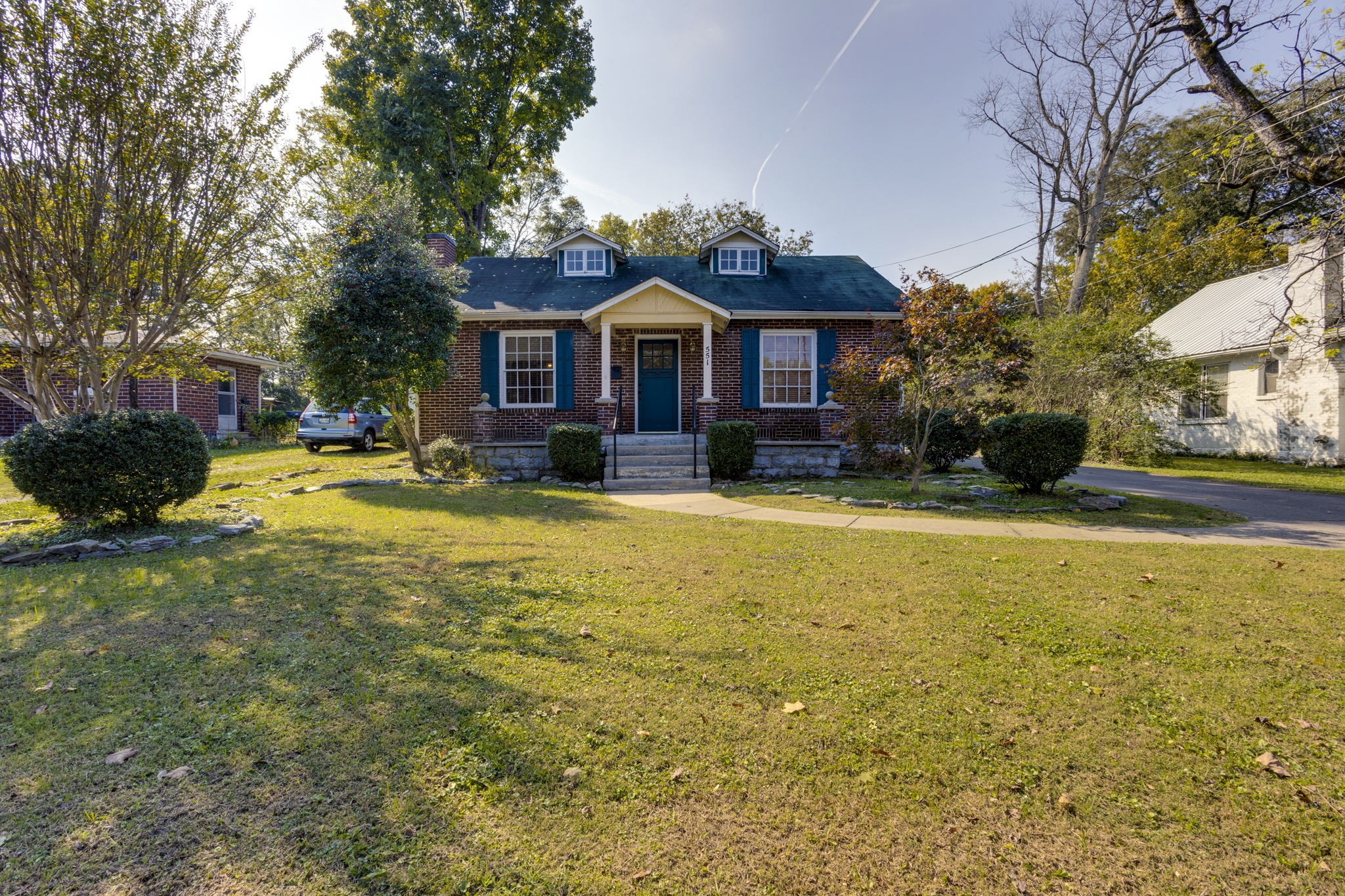 A cozy brick home in a great location just minutes from town! Includes 2 bedrooms, an upstairs flex room, a large lot with a 12x20 shop, the original stone fireplace, a 5x8 laundry room, new flooring, and bright sunroom. This home is move in ready!