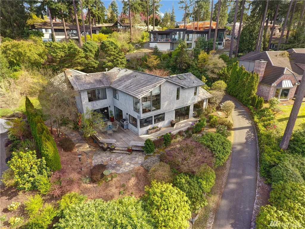 This custom built home sits high atop Aqua Vista in Clyde Hill with views of the Olympics, Lake Washington and the city skyline. The home was designed to enjoy the lake and mountain views. The winding drive way up offers you seclusion amidst a superb community.With a designers touch this home is adorned with sophistication and has spacious rooms and a wrap around deck it is ideal for social gatherings by sunset. Minutes to 520 and 405 with easy access to DT Bellevue.