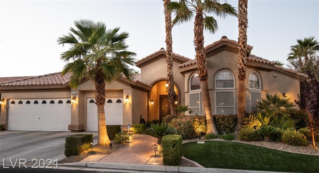 This secluded, gated community with wide streets & well-manicured yards is 10 min.away from Allegiant Stadium, The Strip, & T-Mobile Arena. *Make this inviting residence your perfect retreat* A spacious, open floor plan with vaulted ceilings is filled with designer touches, elegant lighting, slate & hardwod flooring, stunning stone fireplace & a bar area complete with refrigerator & wine fridge; the perfect space for entertaining! Chic formal dining area. Upscale kitchen with stainless appliances, custom cabinets and granite, pantry, wine refrigerator, center island with breakfast bar & a separate built in nook area. Off the great room is a relaxing sun room that leads to a backyard oasis ideal for hosting friends & family; heated pool & spa, fire pit, speakers, expansive outdoor kitchen area w/barbeque, refrigerator, sink & even a cabinet for your TV! Top it off with mountain views & a Strip view!  Sun/security screens on every window. You'lll want to call this place HOME! See tour!