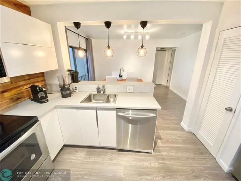 Beautifully Remodeled 2 Bedroom -2 Bathroom Condo in Falls Of Inverrary! Open Kitchen With Brand New Stainless Steel Appliances, New A/C Unit, Fully Upgraded Bathrooms! Huge Balcony and Spectacular Garden and Water Views From This Third Floor Unit!