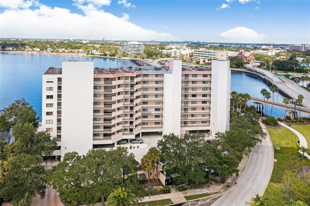 Amazing Location and Spectacular Open Bay Views overlooking Davis Islands, Bayshore, and Hillsborough Bay! Extensive Restoration and Beautification project will bring new life and love for Adalia Bayfront Condominiums. This is the only Direct Waterfront Condo Community overlooking Bayshore with Water Access and walking distance to Downtown Tampa's Riverwalk, Hyde Park, and the Davis Islands town square. Docks are rented to residents only on a first come first serve basis at a low monthly rate including water and electric. This Unit comes with a 10,000 lb boat lift on a wide HOA leased slip, 2 parking spaces, and a small storage unit.  With so much to do just outside your doorstep, you'll enjoy a Unique and Active Florida Lifestyle including fitness, dining, retail, entertainment, and numerous Downtown and Bayshore events. This 2 bedroom and 2 bath condo home with a bonus/den/office area is spacious at 1592 sq ft with another generous 248 sq ft on the balcony.  This home is light and bright bringing in lots of natural light throughout the space. Too bright – close the electric hurricane shutters for total privacy and protection.  Use the home the way it is or customize it to your needs with plenty of square footage to do so.  Consider converting the bonus/den/office space into a true third bedroom to add instant value and equity. Prime location, Prime Views, Prime Lifestyle – book your private showing today and see what you've been missing!