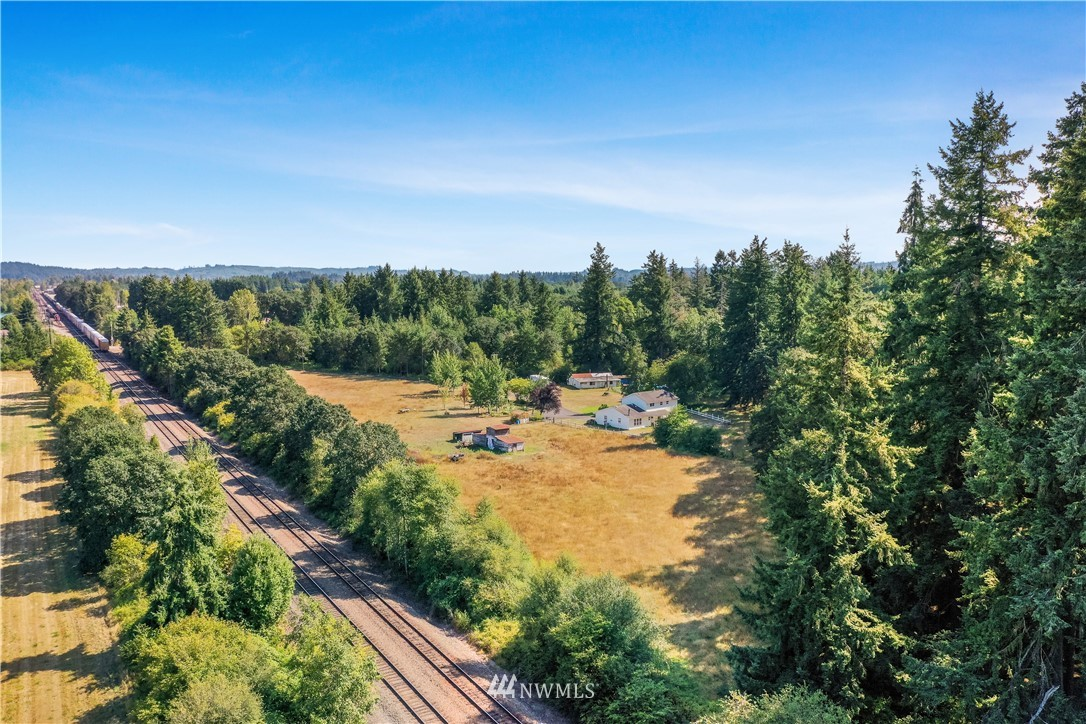 9.91-acre site in a growing industrial area of north Lewis County. Mid-way between Seattle and Portland. Possible rail access. Adjacent ±30 acres also available (through a separate agent). The buyer could purchase both for a ±40 acre development that fronts Harrison Ave. Single-family home and outbuildings included.