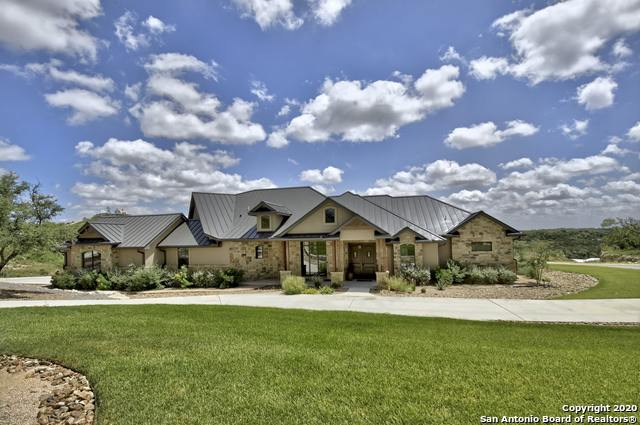Views! Views! Views! Gorgeous Hill Country, lodge style, retreat on a corner lot offers much serenity just minutes from city amenities. Enjoy unobstructed sunrise views for miles from the spacious covered patio/deck. True one-story living at its finest in a home loaded w/custom stone & warm wood accents. The open floor plan includes both formal dining & eat-in kitchen, executive study, butler's pantry & bonus room for entertaining. The furniture is negotiable and a second lot is available for added privacy!