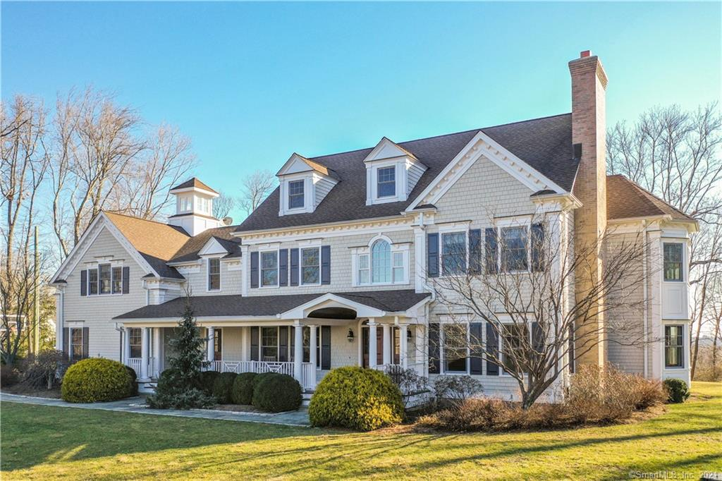 """Prepared to be amazed with all that 144 Signal Hill Road has to offer. Sited perfectly on the property to take advantage of the expansive views & sun filled level yard.The stone wall & newly paved driveway (2019) draw you into this stunning home which was freshly painted in 2020 including trim, pergola & stained front/back decks. Quality crafted millwork throughout the home w/9ft ceilings on all 4 furnished levels. Expansive foyer w/coffered ceiling conveniently opens to formal living rm & dining rm w/wet bar including built in cabinetry & beverage refrigerator. Bright white chef's kitchen with 6 burner Wolf stove & large island opens to spacious family rm w/fireplace. Both rooms include french doors to the backyard, slate patio & firepit. Gorgeous home office w/built ins make working from home a pleasure. This open floor plan lends to the perfect work/play & entertaining environment. The master suite is spectacular w/double vanities, soaking tub & water closet, dual, custom closets, fireplace & separate sitting/office area w/french doors to your private balcony. Bonus family room w/built ins & access to kitchen from back staircase. Finished 3rd floor is the perfect extra space to spread out and includes half bath.The lower level continues to """"Wow"""" w/private home theater & bonus finished space. Full list of improvements & professional drawings for possible pool site included with the listing. 144 Signal Hill Road is truly the safe oasis that you will want to call home today."""