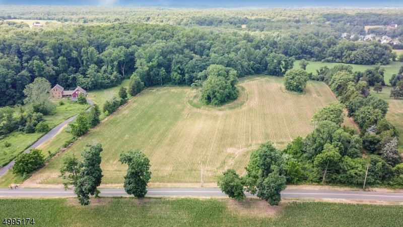 "Your Dream Home is ready for you to build. This 10 plus acre lot has been town approved sub divided into two lots. With one home sitting in the front and a second home on a flag lot sitting in the back. Both homes would have a shared drive way easement which splits off to the two properties. The top left corner of the property has been approved for a barn. Build two homes or just one and have the most magnificent views with your home majestically sitting on over 10 acres. The land is rich as it has been used as farming fields for years. The property backs to township owned preservation property. Build your dream home in the ""Mansions at Allamuchy"" section. The seller has all the plans for the subdivision. Much of the work has been done already. Lot is being sold as one, currently farmland assessed."