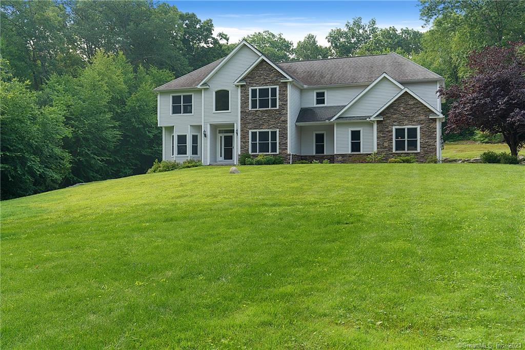 South Glastonbury Gem!! Spacious 4 bedroom, 3 full bath, 2 half bath Colonial on 3.47 acres on a CUL-DE-SAC!!! Enjoy the 3,833 sq.ft. of open concept family home with an additional 1,200 sq. ft. bright walk-out fin basement. Enter the bright 2-story foyer with spacious office/den to one side and formal dining room to the other followed by a 2-story sunny family room with gorgeous floor to ceiling f/p & hardwood floors. The enormous eat-in kitchen has an island and some newer appliances including dishwasher & ice maker, a fabulous Wolf propane stove with pot filler, walk-in panty and h/w floor. Laundry room off kitchen has newer washer/dryer and a powder room finishes off the main level. Upstairs is a welcoming second story foyer open to family room with h/w floors. The extra large master bedroom suite also with h/w leads you to a just as amazing master bath with jetted tub and huge walk-in closet. The second bedroom has it's own full bath (could be guest room). The third & fourth bedrooms are spacious with good sized closets. The lower level is a walk-out finished basement with it's own powder room and is plumbed for a wet bar. Deck was recently extended and an entire screened in room was added for add'l relaxing space. This lovely home features c/a, c/v, new water softening system, whole house generator which automatically switches on when power goes out. Enjoy the nearby farms for fresh fruits & veggies, yet close to town and highways. Best of all worlds.