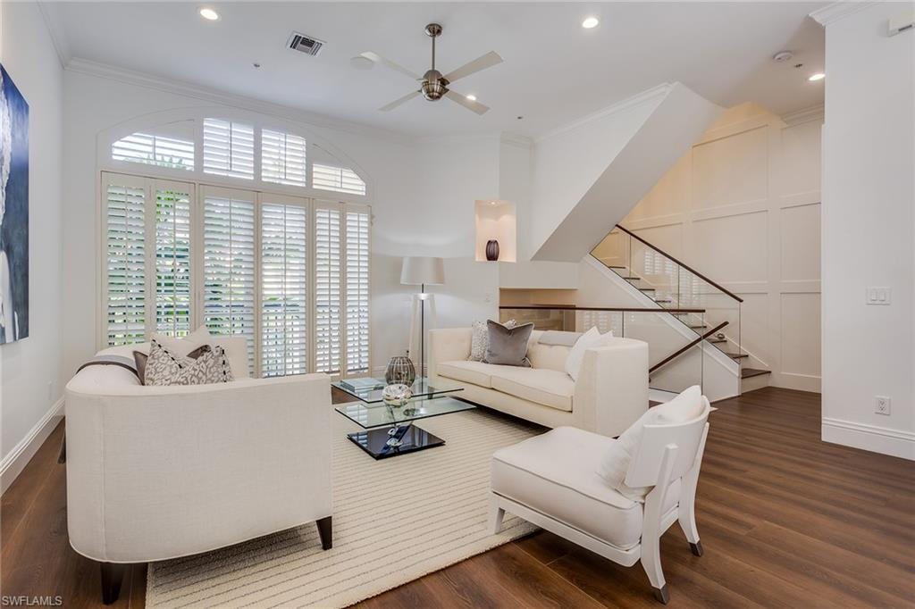 This recently updated villa is wonderfully located only two blocks to the beach and at the corner of the world-renowned 5th Avenue South. Whether you choose to enjoy shopping, dining at one of Naples' fine restaurants, or taking in a sun-filled beach day, they are right at your doorstep! With a modern interior and custom finishes throughout, this immaculate villa has quality, sophistication and style. The interior living space includes a generously sized master suite, 2 additional bedrooms, 2 full and 1 half baths, den, and a bright open living/dining and kitchen area. Additional features are wide plank wood floors, Viking and Bosch kitchen appliances, plantation shutters, one car attached garage and a lovely outdoor courtyard with spa and private tropical landscaping. A must see if you desire a beautiful villa in the heart of Naples!