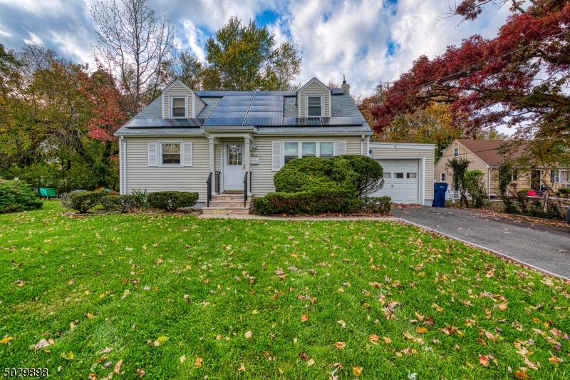 A Charming Cape Cod located on a quiet street, just a 5 minute walk to the center of town and to the Fanwood Train Station!  This Energy Efficient Home is a well-maintained gem with hardwood floors on both levels. The gorgeous renovated kitchen boasts a breakfast bar with casual seating, a separate dining area, granite countertops and SS Viking appliances. A grand family room with vaulted ceilings off the kitchen was added in 2005. Two sizable bedrooms and a full bathroom downstairs. Upstairs two more bedrooms and another full bathroom beautifully refinished with heated tile floors. Full finished basement perfect for fitness and recreation. Ample storage space throughout the home. Relax or entertain on the trek deck off the kitchen in your private backyard.