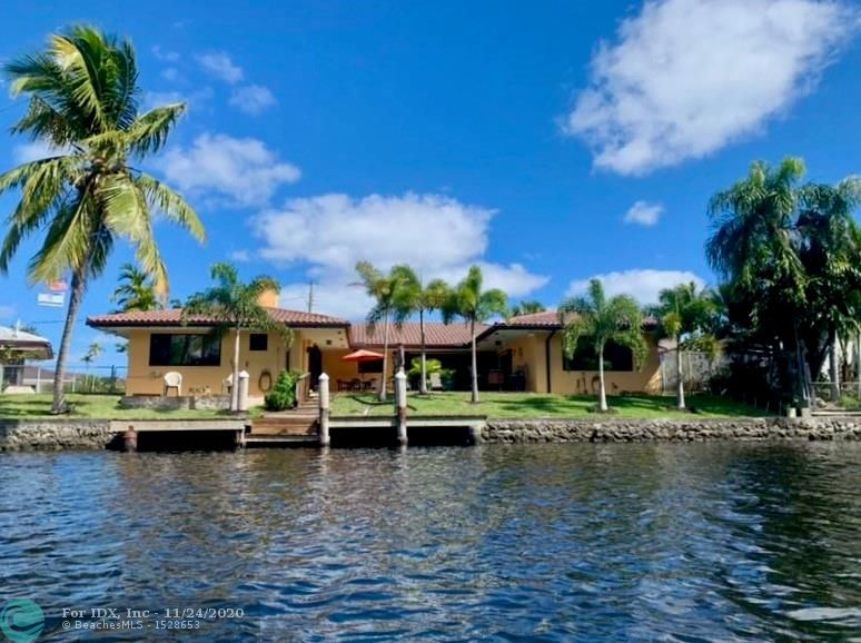 Welcome to your gorgeous home on Wilton Manors' gated private island, Jenada Isle! Large lot with 110' of WATERFRONT & a view of natural woodlands. This extensively updated 3 bedroom, 3.5 bath, plus office & 2 car garage is waiting for you. Kitchen updated 2019/2020, solid wood cabinets, Upgraded SS LG appliances, Quartzite countertops. Step-down Living Room approx  23' x 20' with large Bay Window, quadruple pocket slider that opens to a screened lanai leading to large 868 sq ft patio. All Impact windows, accordion shutters on sliding glass doors. River view from Owner's suite that was remodeled in 2017, Owner's bath includes dual sinks, large shower with beautiful custom mosaic design and bench, recycled glass countertops, and walk in closet. Home has too many upgrades/features to list!
