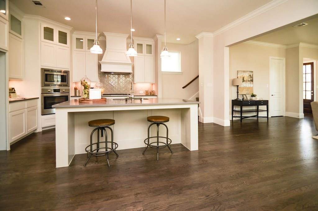 One of the last SLC home that is available for immediate move-in. Includes Bosch Refrigerator and 4 inch Plantation Wood Shutters.  Upgraded new construction,3 car garage, see feature sheet for included specs and schedule private tour today before it's gone! This elite home has it all; custom flooring throughout, high ceilings and an open floor plan. Gourmet kitchen offers granite counters, SS appliances, tall cabinets and ample storage. Fall in love with your master retreat with the neutral paint, dual sinks, walk-in closet. Enjoy entertaining or your favorite cup of coffee under your spacious covered patio. See link for HOA amenities, home specs, features and included upgrades.