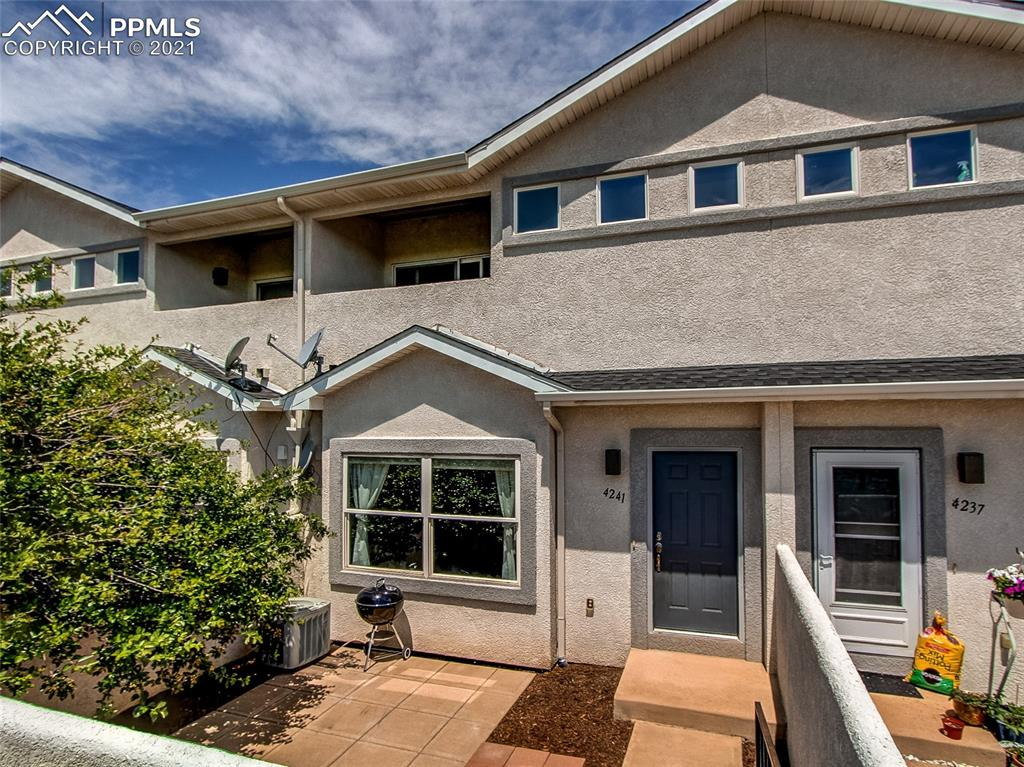 This really nice townhome has fresh paint and carpet throughout.  Welcoming front with courtyard facing the open space and mountains!  Conveniently located close to I-25 and Fort Carson!  Spacious feel with 9' ceilings on main level and vaulted ceilings upstairs.  Light and bright open living room with large windows in front and built-in shelves.  Kitchen has updated oversized composite sink and faucet with sprayer and soap dispenser, all appliances including new garbage disposal, plenty of counter and cabinet space, including pantry cupboard with chalk paint.   Two master bedrooms suites upstairs, each with its own private bath, vaulted ceilings, walk-in closet and covered balcony!  One of the upstairs baths features a soaking tub with rain shower and double vanity.  Surround sound on main level.   2 car attached garage with shelves, new roof and gutters.  AC makes this home very comfortable!
