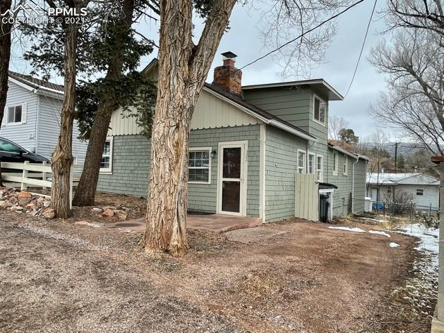 Mostly one-level living in a tucked away neighborhood in Manitou! This well-kept home features 2 stone fireplaces with gas lines installed, a large deck in the back, and a fenced backyard. The kitchen has ample cabinet space, and a gas range/oven. Laundry is onsite and also has a gas hookup. Attached workshop is perfect for storing yard tools, doing hobbies, or storage. Upstairs is a spare bedroom would also make a great office or gym, with lots of light and nice views. Everything besides the upstairs bedroom is on the main level. Neighborhood is quiet with easy access to Hwy 24, downtown Manitou, Garden of the Gods, Old Colorado City, and more! Home makes a great owner-occupied or investment property. Come take a look!