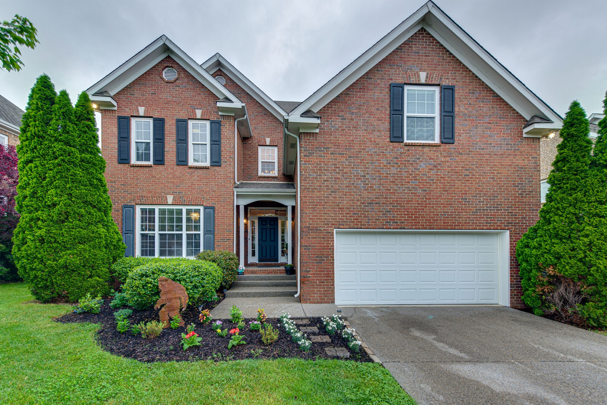 This all brick Williamson County home features a bright open floor plan, formal dining room, extra large bonus room with fireplace, oversized dream kitchen, 5 spacious bedrooms with large closets, hardwood and tile floors, the list just goes on and on...   Showings begin 5-1-21