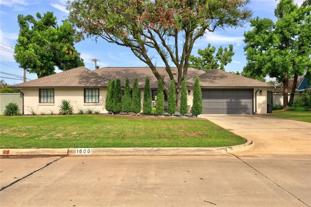 Beautiful home in sought after Nichols Hills! Home has been newly landscaped for privacy! Complete renovation in 2015. Features include updated electrical wiring, HVAC, plumbing, hot water tank, privacy fence and driveway. Additionally, there are new windows throughout, beautiful wood floors and a completely open concept floor plan. Kitchen flows right into dining area and living area. Kitchen features white quartz counter tops and newly built cabinetry, along with all new appliances! Gorgeous custom gas fireplace in living room is a true center piece. Large walk in pantry off of kitchen. Full bathroom off of the office space, which is separate from all bedrooms. Spacious laundry room. Beautiful french doors in master bedroom let in natural sunlight and lead out to a separate patio. Master bathroom carries consistent design throughout with white quartz counters, marble floors, soaking tub, and large shower with rain head. LARGE master closet is a dream with custom cabinetry and vanity.