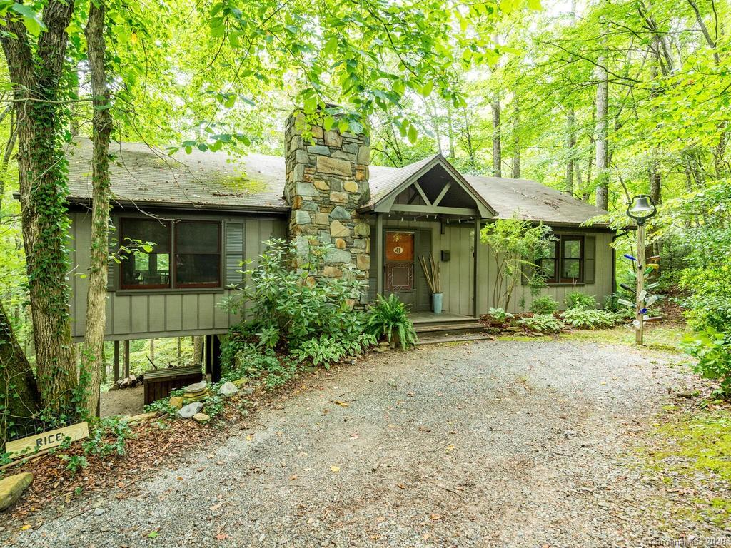 Peaceful cabin in the woods less than 30 minutes to Asheville and under $250k!  Located in the popular McGuffey Ridge subdivision in Gerton, this home would make a wonderful primary residence or second home mountain getaway.  Currently set up as a successful VRBO rental.  Very cute and well maintained cottage.  Open floor plan layout with wood burning fireplace.  Huge covered rear deck.  Only two owners.  Small HOA fee covers the water bill.  Wonderful hiking trails just minutes away.  Gerton is conveniently located.....just 25 minutes to downtown Asheville, 30 minutes to Hendersonville, 15 minutes to Chimney Rock, and only 12 minutes to closest grocery store, post office and bank.  A wonderful home in a wonderful area!