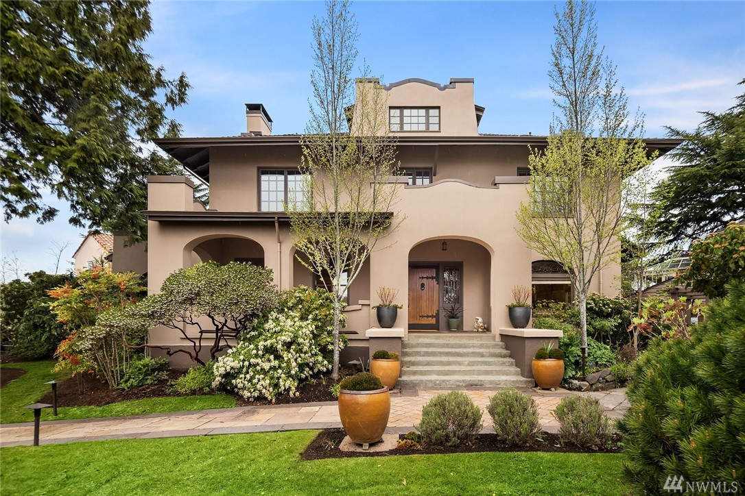 A jewel of Webster Point, this stately Mission Revival looks out across Lake Washington to Mt Rainier. Original old world millwork with a combination of leaded and stained glass windows transports you back in time. Mahogany ribbon inlay oak floors grace main and 2nd floors. Surrounded by similar style homes with terracotta roofs make this enclave reminiscent of coastal Santa Barbara. Exquisite gardens, water feature, a private patio, and an entertainment deck complete this stunning  property.