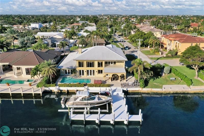 LOOK NO FURTHER, FOR HERE IS ONE OF THE MOST INTERESTING DIRECT INTRACOASTAL HOMES CURRENTLY AVAILABLE FOR PURCHASE IN HIGHLY DESIRABLE LHP! OFFERING A RARE PERPENDICULAR T-DOCK EQUIPPED WITH A BOAT LIFT & JET SKI LIFTS, THIS BACKYARD HAS IT ALL: POOL, COVERED PATIO AREA, A SUPER VIEW AND SO MUCH MORE! IMAGINE HAVING THIS 4 CAR GARAGE, WHERE YOU CAN KEEP A TOY OR TWO! ENTER THIS HOME PROVIDING SOARING CEILINGS, A GOURMET'S KITCHEN, BAR AND A GENEROUS FLOOR PLAN PERFECT FOR ENTERTAINING AND THE LIGHT AND BRIGHT FLORIDA LIFESTYLE THIS 4 BEDROOM + LARGE OFFICE, 4FULL/2HALF BATH HOME OFFERS. UPSTAIRS IS A HUGE MASTER SUITE YOU CAN ALMOST LAND A SMALL CESSNA IN. ON THE NORTH SIDE OF THE PROPERTY IS A NICE GREEN SPACE. FURNITURE ALSO FOR SALE. HURRY BEFORE THIS ONE IS GONE!