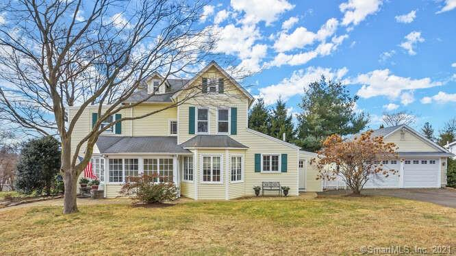 """You will feel perfectly AT HOME the moment you step foot into this beautifully maintained 4 BR Colonial Farmhouse in a fantastic University Neighborhood!  Charm, character & warmth are just a few words that come to mind! Located on an oversized corner lot w/ generous front, side & back yard space- there is plenty of options for outdoor play, gardening, lounging, etc. Come on inside & you are instantly greeted by an abundance of natural sunlight, beautiful window detail, glistening hard wood floors,  french doors w expansive passthroughs &  period detail. Updated EIK w/ SS appliances, granite countertops, tons of cabinet space & attached mudroom.  GREAT flow & tons of space for entertaining in the generously sized DR, LR, FR w/ Gas Fireplace & front Sun Room/Study.  Full bath w tub/shower on main floor.  Upstairs, you will find 4 generously sized bedrooms (one w/ LG attached dressing room)  & one full bath w tub/shower. The finished walk up attic /bonus room offers more additional space- a great place for home office, hangout space, etc. Exterior features are 2 options for """"outdoors""""relaxing- large back deck (accessed via mudroom) perfect for summer lounging & bbq's and a quintessential fully enclosed side front porch.  Clean & tidy detached 2 car garage offering plenty of room for addT'L storage, potential home gym. Enjoy the conveniences of gas heat, centralA/C, public water & sewer.   Close proximity to shopping, restaurants, I-95 &  MerrittPkwy. SHOWINGS BEGIN Tuesday 1/26"""