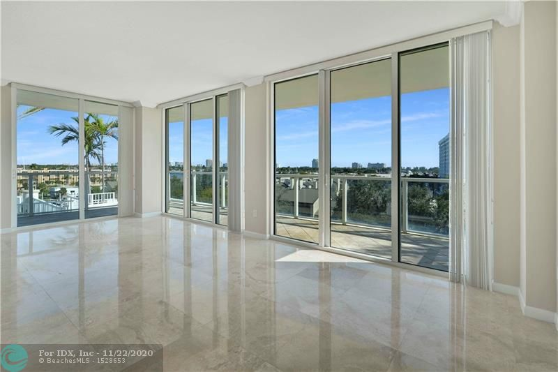 Desirable Corner Unit w/Water views; 3 Bdrms/2.5 Baths w/Open Living Space; Culinary Kitchen w/ Euro Cabinetry; Granite Counter tops & Stainless Steel Appliances; Laundry Room w/full-size Washer/Dryer in Unit; Enjoy the 10' Ceilings with Floor to Ceiling Hurricane Impact Windows & doors w/wrap-around balcony; Split Bedroom Floor Plan--Includes Two Garage Parking Spaces & Extra Storage. Extraordinary Amenities incl: Fitness Center, Clubhouse w/Outside Patio Area & Kitchen Facilities, Heated Pool/Spa; Concierge/24-Hour Lobby Attendant, Business Center w/Offices & Mgmt on Site.  Cable & Internet ARE included in monthly fee--Pet Friendly (2 Dogs Allowed); Truly a Great Location--Close to Fabulous Restaurants, Shops, Beach and Airport!  An Impressive Place to call Home for your Extended Stay!