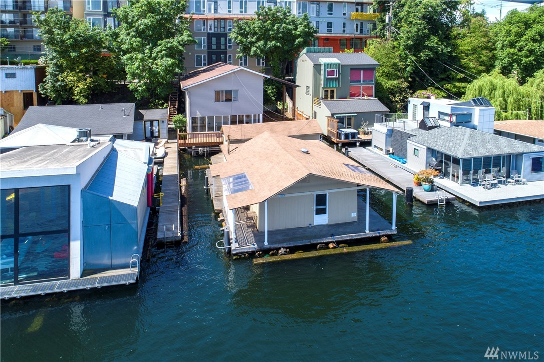 Rare Portage Bay Opportunity! 50 feet of Lake Union waterfront with a front row floating home. Property also includes a home on land with a two-car garage, floating dock, a floating workshop/shed and moorage slip. Incredible potential and a unique opportunity to make this your own waterfront urban paradise. (float is approximately 43x29). You're the Captain!