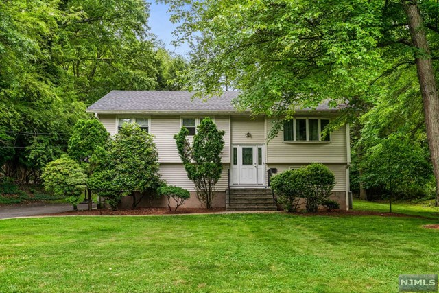 Great opportunity to live in the sought after town of Closter. This beautifully maintained Bi-level home situated on the prestigious east hill of Closter, welcomes you and your family to enjoy all the luxuries this fabulous home has to offer.  The entry foyer welcomes you to an open floor plan, a delightful formal living room, a sun drenched dining room, modern kitchen and family room with a fire place. More highlights await, three bedrooms and an updated full bath and a conveniently located laundry room complete the upstairs.  Outdoor is 'your thing', simply glide through to sliding glass door to the spacious deck. The ground level features an additional two bedrooms with a full bath, access to the private backyard, two car garage and work room/utility rm. What a wonderful chance to live in one of this counties premiere small towns with easy access to NY, Blue ribbon schools, close to Closter Plaza and close to public transportation to the City.