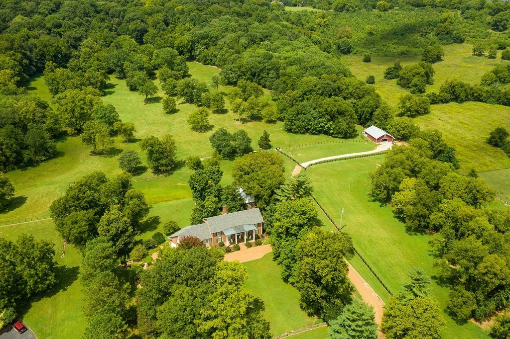 Amazing farm, incredible home, superb building sites, this is a gorgeous, 55acre, one of a kind estate. The 5414SF, 5BR, 5 and 2 half bath, high quality all brick construction home is surrounded by beautiful, park-like middle TN scenery. Abundant storage, 4 garage spaces, including 1 in the basement with the excellent shop, and a 2nd kitchen. Currently a horse farm, the pristine pasture and woodland is fully fenced with a sturdy barn/stable. Level hilltop build sites. Only 35 minutes to Franklin