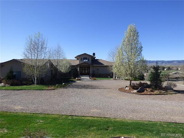 """Quiet private setting*Unobstructed 180 degree views all the way to Pikes Peak*Contemporary custom Ranch on 2.2 acres designed by 2008 Parade of Homes award winner*Open floor plan is perfect for entertaining*Stunning-nothing short of spectacular*True Country in the City Living zoned A-1 allows HORSES*Fully fenced*Dramatic entry boasts gleaming Brazilian Cherry flooring/leaded glass doors*Main floor master suite, gas fireplace, French doors to Trex deck, and all the comfortable luxuries*Main floor 2nd master/mother-in-law suite features separate sitting retreat/separate garage access *3 fireplaces*Expansive great room, 19 foot ceilings*Handicap features-36"""" doors, 52"""" hallways*Main floor study*Gourmet kitchen-gorgeous details*Finished walk-out basement, wet bar, fireplace, 3 beds-private baths*Built-in speakers*2 laundries*3 furnaces, 3 AC, 2 water heaters*Central alarm*Heated tile floors*Extensive decks/patios, professional custom landscaping, sprinkler*Oversized 4 car attached garage*"""
