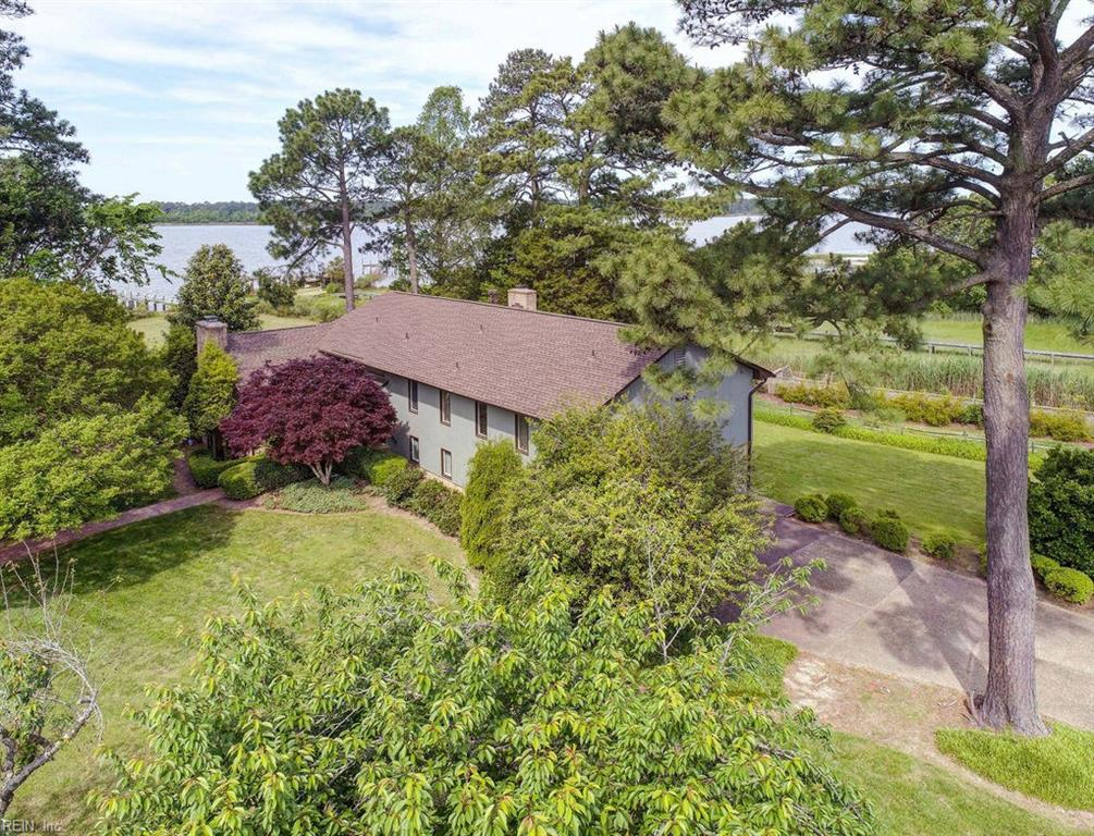 OVERLOOKING THE JAMES RIVER AT THE MOUTH OF THE WARWICK RIVER THIS CUSTOM BUILT ONE OWNER HOME BOASTS WATERFRONT VIEWS FROM ALMOST EVERY ROOM. BLEND OF CONTEMPORARY WITH A TOUCH OF MIDCENTURY MODERN . A  LIGHT FILLED HOME FEATURIING SLATE,HARDWOOD AND CERAMIC FLOORING,TWO MASONRY WOOD BURNING FIREPLACES,VAULTED BEAMED CEILING,FLOOR TO CEILING WINDOWS , SCREENED WATERSIDE PORCH AND PRIVATE COVERED CANTILEVERED BRICK  WATERFRONT TERRACE.LIVING AND DINING ROOMS,EATIN KITCHEN,FAMILY ROOM AND RECREATION ROOM ALL OVERLOOK PANORAMIC  WATERVIEWS  WITH A SANDY BEACH.MINUTES FROM CITY CENTER AND RIVERSIDE HOSPITAL THIS CENTRAL LOCATION IS A QUITE WATERFRONT ESCAPE.