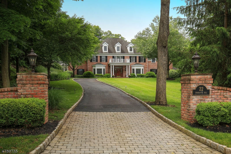 An exceptional Bernardsville estate neighborhood provides the setting for this classic Georgian Manor. Present/first owners, including an interior designer, have virtually accomplished perfection from its elevated setting on the curve of a cul-de-sac to its comfortably elegant aesthetic. All brick exterior, 2-story foyer, coffered and tray ceilings, refined moldings, charming arched entries, wainscoting, multiple built-ins and French doors, 4 fireplaces. Mahogany library, sunroom. Kitchen updated 2016 sports white cabinetry and double quartzite countertops. Master suite w/ sitting room opening to balcony, luxurious travertine bath. California closets t/o residence. Finished lower level w/ mahogany wine cellar; game, exercise, 2nd family rms, office. Beautifully landscaped grounds including English Garden.