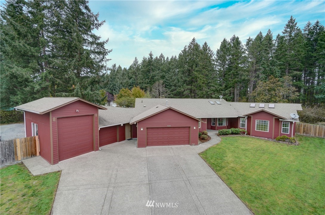 Welcome Home.  This beautiful 2334 Sqft,  2 bath rambler offers 3 very good sized bedrooms with the master having a walk in closet.  Main living areas have New carpet. This home offers ample parking inside and out. The Garage is 1361 sqft and can fit 5 car with room for a lift bay, and gravel RV parking alongside for easy access.  The property wont disappoint its over .600 of a acre with plenty of room for entertaining with a huge deck off the kitchen.  JBLM Greenbelt on the backside of the property.