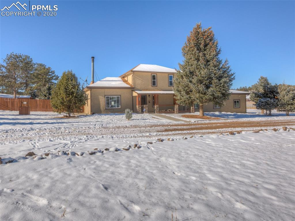 This Beautiful Stucco home is move-in ready on 11.31 acres zoned for horses and includes an RV Pad with full hookups for water, electric and sewer.  Convenient location just minutes from downtown of Florissant, 15 miles from Woodland Park, 13 miles to Cripple Creek and next door to the Florissant Fossil Beds.  New carpet and water heater in 2019, cozy tongue and groove ceilings, wainscot on walls in living room with gorgeous vaulted ceiling and sky light.  Forced air heat with a Wood burning fireplace that heats the whole house.  Spacious kitchen with breakfast bar. open to living. 3 bedroom with office that can be a 4th bedroom, media room or workout space.  Gated circular drive. 400+ square foot covered back patio for entertaining.  Oversized two car attached garage with room for a long bed quad cab truck, separate workshop, storage room and an adjacent 3rd bay with roll up door perfect for toys, storage and more.  National Forest, hiking trails, fire station, and park nearby.  Great Pikes Peak views from front porch and living room.   Separate fenced backyard with 3 fenced pastures, two loafing sheds, and a 5 stall barn with tack room and storage.  Adorable treehouse for the kids and room to roam.  This home is the perfect retreat or horse property with lots of room to enjoy the beautiful outdoors.  * Kioti Tractor in barn is available for purchase *