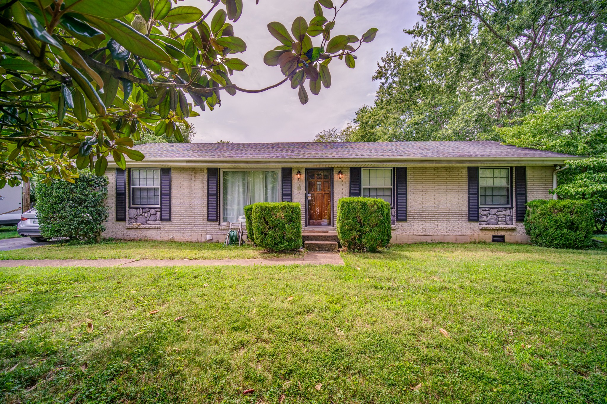 Located on a beautiful tree lined street just minutes from East Nashville is this charming ranch style home. It was recently renovated with a new roof & HVAC, as well as fresh carpet & flooring throughout. This mid-century modern gem also features a remodeled bathroom & a separate garage with a bonus room above it. If you're hunting for a blend of comfort, character & curb appeal, look no further.