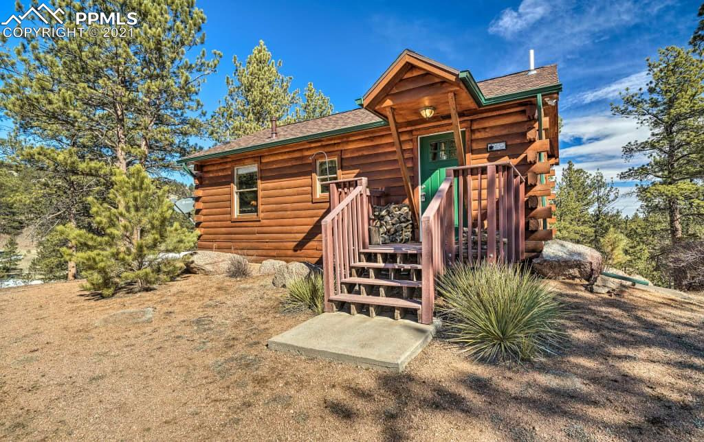 This is It!! You will love this Mountain Retreat Cabin that is in a gated community on Lake George.  Fishing is just a walk away and hiking is right out your door, borders National forest! This cabin is so cute, well kept and cozy.  Great room with living room/dining/kitchen walks out to a trek deck. This 2 bedroom,1 bath cabin is Move in Ready.  All new appliances and new energy efficient Honeycomb Shades on all windows.