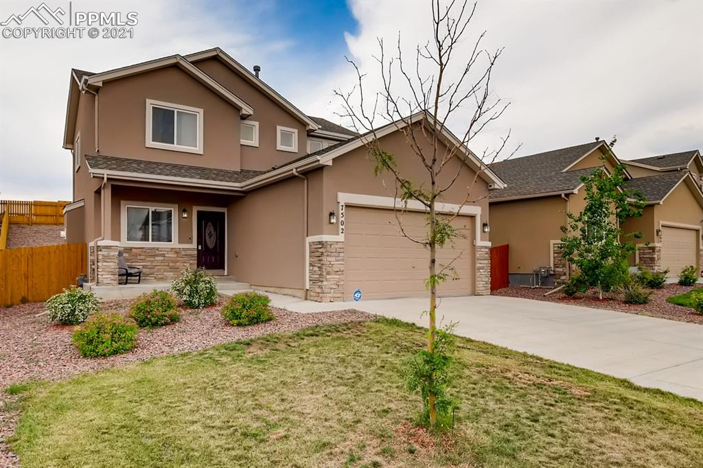 This beautiful 2015 home is move in ready. Conveniently located close to shopping & dining and just a short commute to the area military bases! You will be wowed by the thoughtful floor plan and open concept living-dining area throughout the main floor. The large kitchen features engineered hardwood flooring, granite countertops, center island, a large pantry, and stainless appliances with built in Beverage Fridge! Walk out from the dining area onto the concrete patio and enjoy your large fenced in back yard with level grassy area, and rocked area up to the rear fence line.  Cozy up in front of gas fireplace on those chilly nights Colorado is known for! This home is an impressive total 2354 sq feet and boasts 3 bedrooms, 3 bathrooms and upstairs laundry room. The primary bedroom is spacious and bright with a large attached 5 piece bathroom and walk in closet! The basement is a spacious 748 sq ft, blank canvas for you to custom create the basement space of your dreams! These are only but a few of the many reasons you will want to make this your new home!