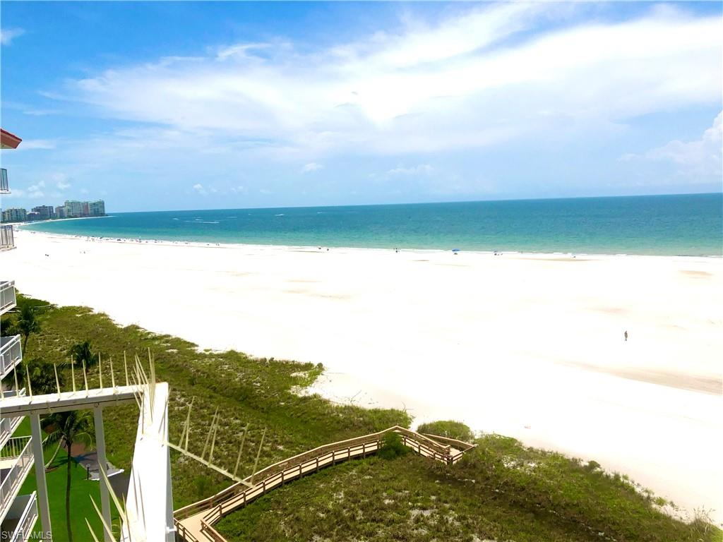 -Front Jet-Out unit with the best views in the building, plus extra side windows in each bedroom for air circulation. and beach views. All new impact hurricane glass 2021. All newly remodeled baths, new luxury vinyl flooring, granite counters and stainless appliances. New 6 panel solid wood doors.  The largest private balcony in the building, overlooks the entire beach from North to south. Gulf and pool views. Newer modern style furniture. New black-out drapes. TV'S on remote to raise up to the ceiling when not in use. Every room has a beach view. Split bedrooms. Turnkey Furnished. Covered parking with extra storage. Parking in the first row closest to the building. Extra storage closet down the hall. Laundry directly across the hall. Tradewinds building has recently been upgraded and remodeled with a new roof, hurricane glass. All assessments have been paid.